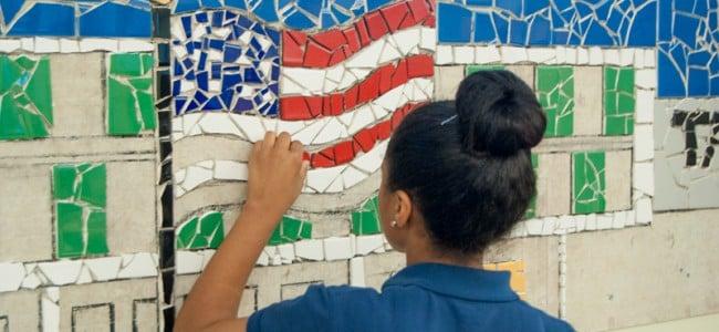 Ashley working on Tacony Academy Charter High School mural