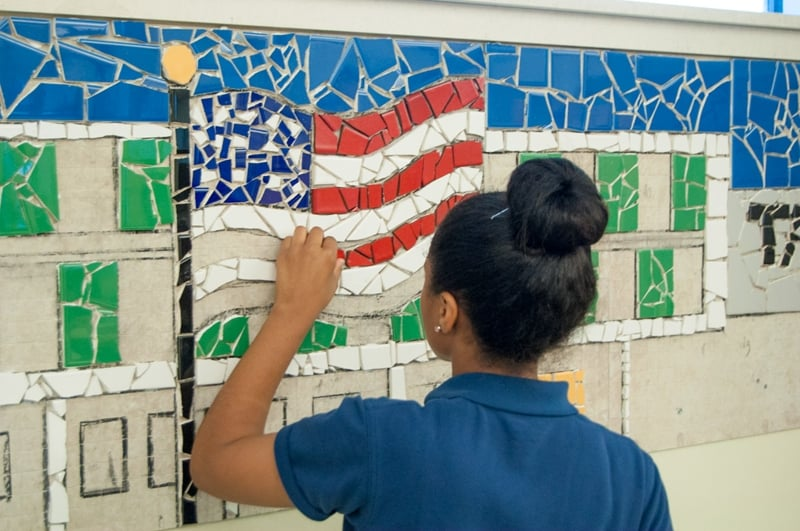 Ashley working on Tacony Academy Charter High School mural