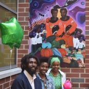 Misty Sol creates a mural for the Musical Garden Program at Bluford Elementary